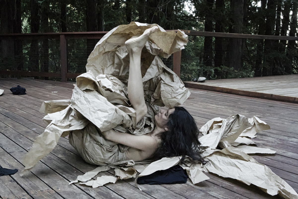 """Performance view of the piece titled """"Paper Dance"""" by Janine Antoni."""