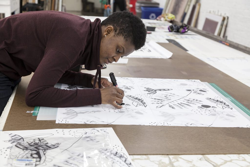 Former FWM Apprentice Alexandra Antoine working in the print studio.
